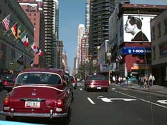 Lucy, Desi, and Steve Jobs thinking Different with two Saab 96 V-4s on Third Avenue in Manhattan.
